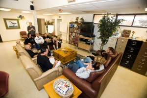 people sitting around on couches