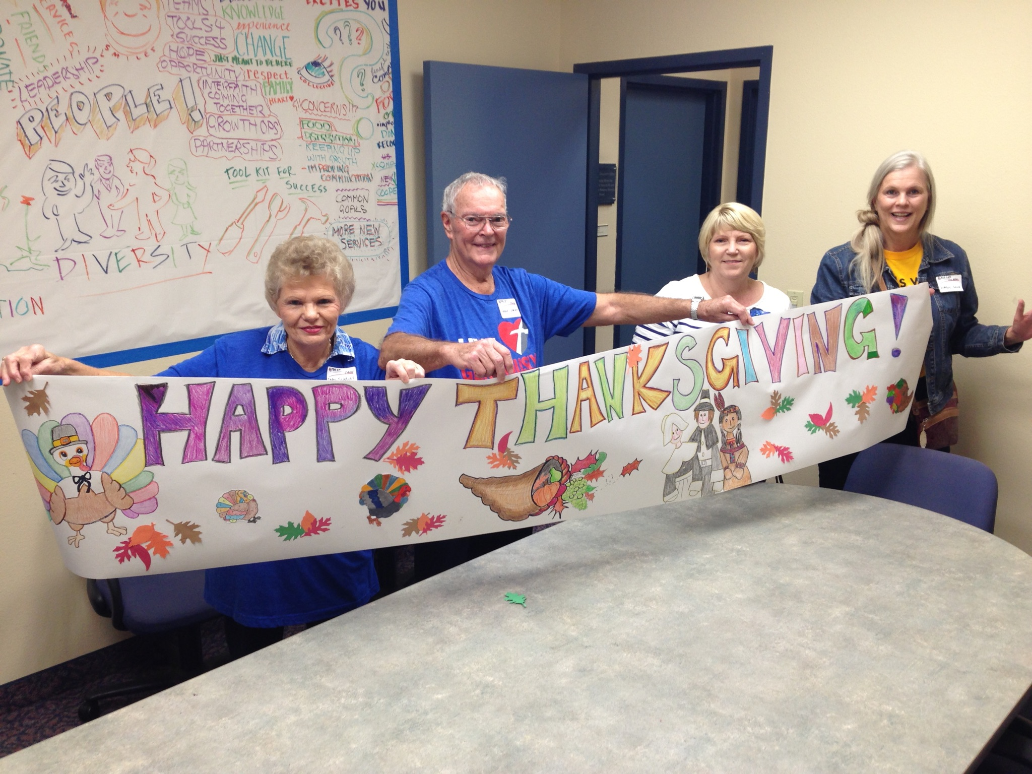 seniors holding happy thanksgiving sign
