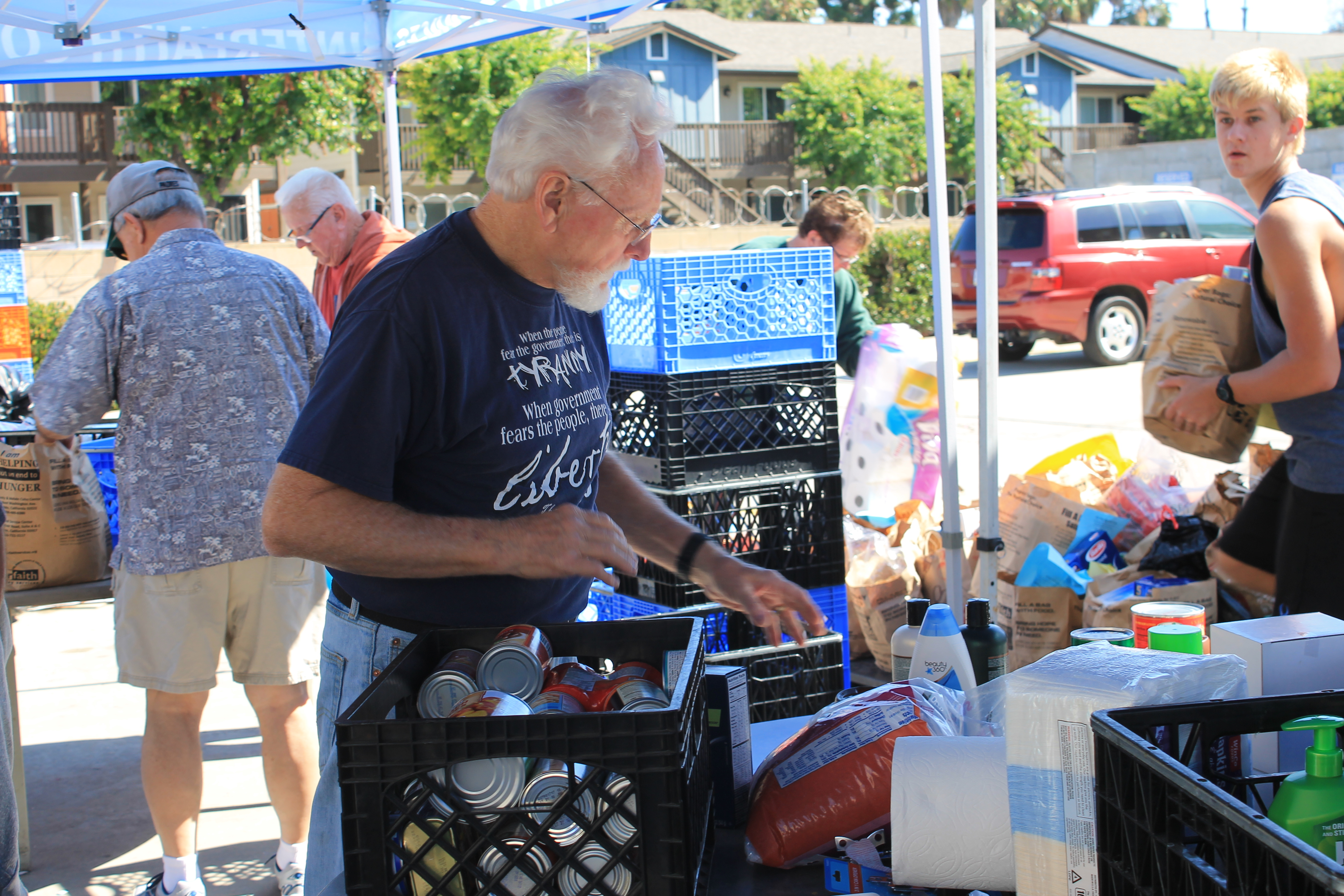 man working food donation booth