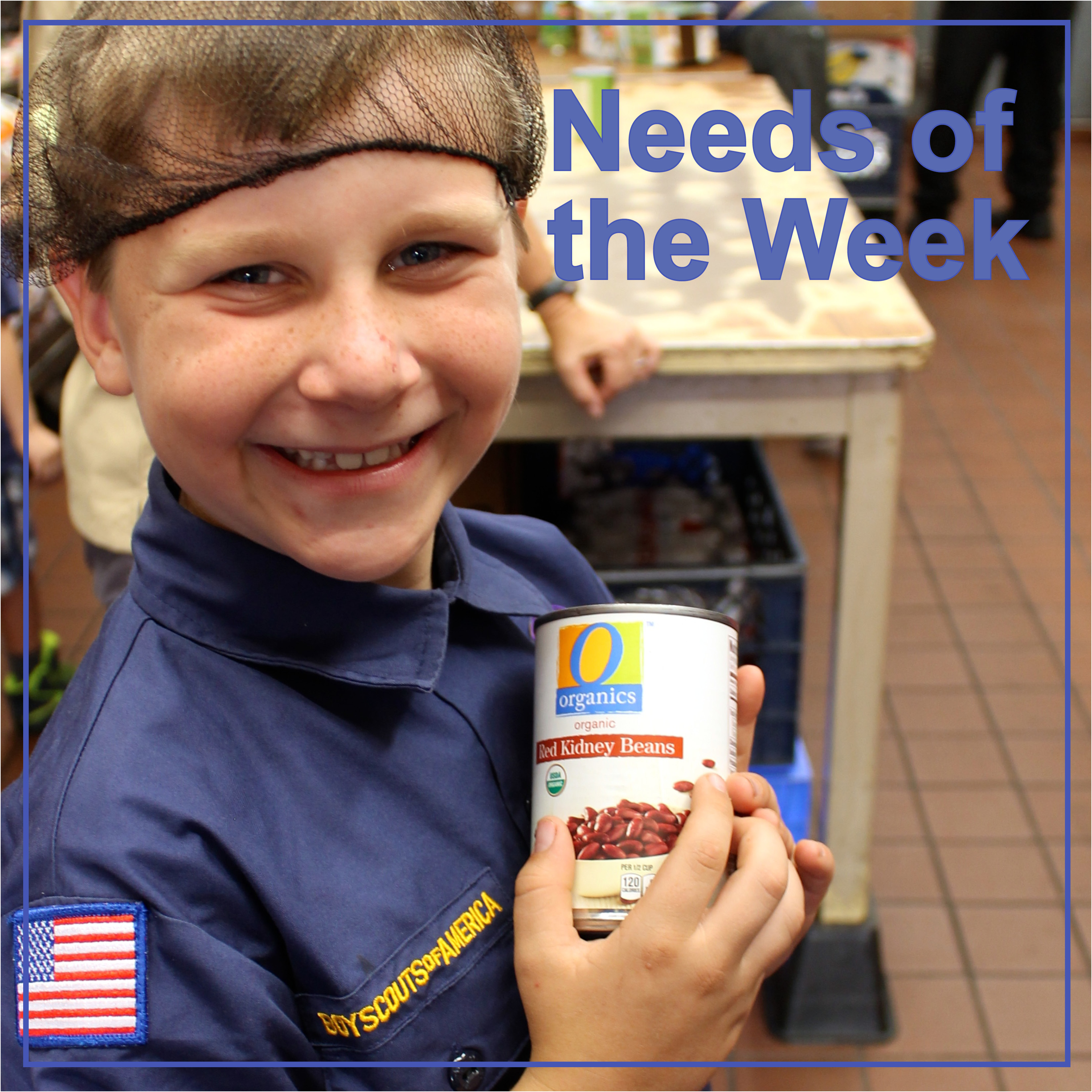 needs of the week boy holding canned food