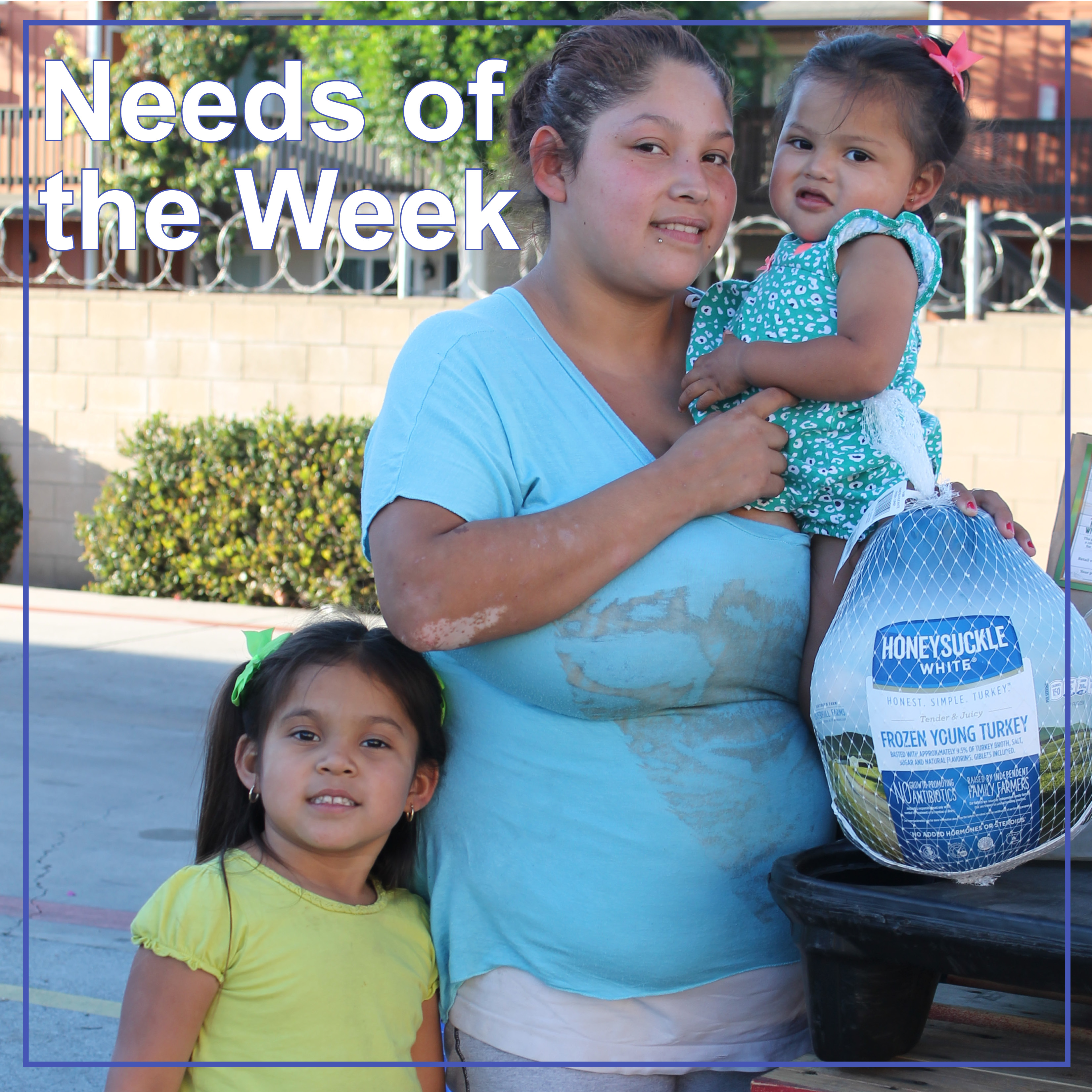needs of the week family holding turkey