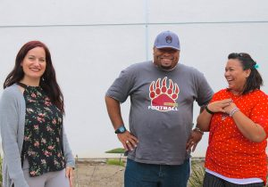 Big Sid (center) with Interfaith's Veterans Pre-Licensed Clinical Therapist, Crystal (left) and Housing Coordinator Celina (right).