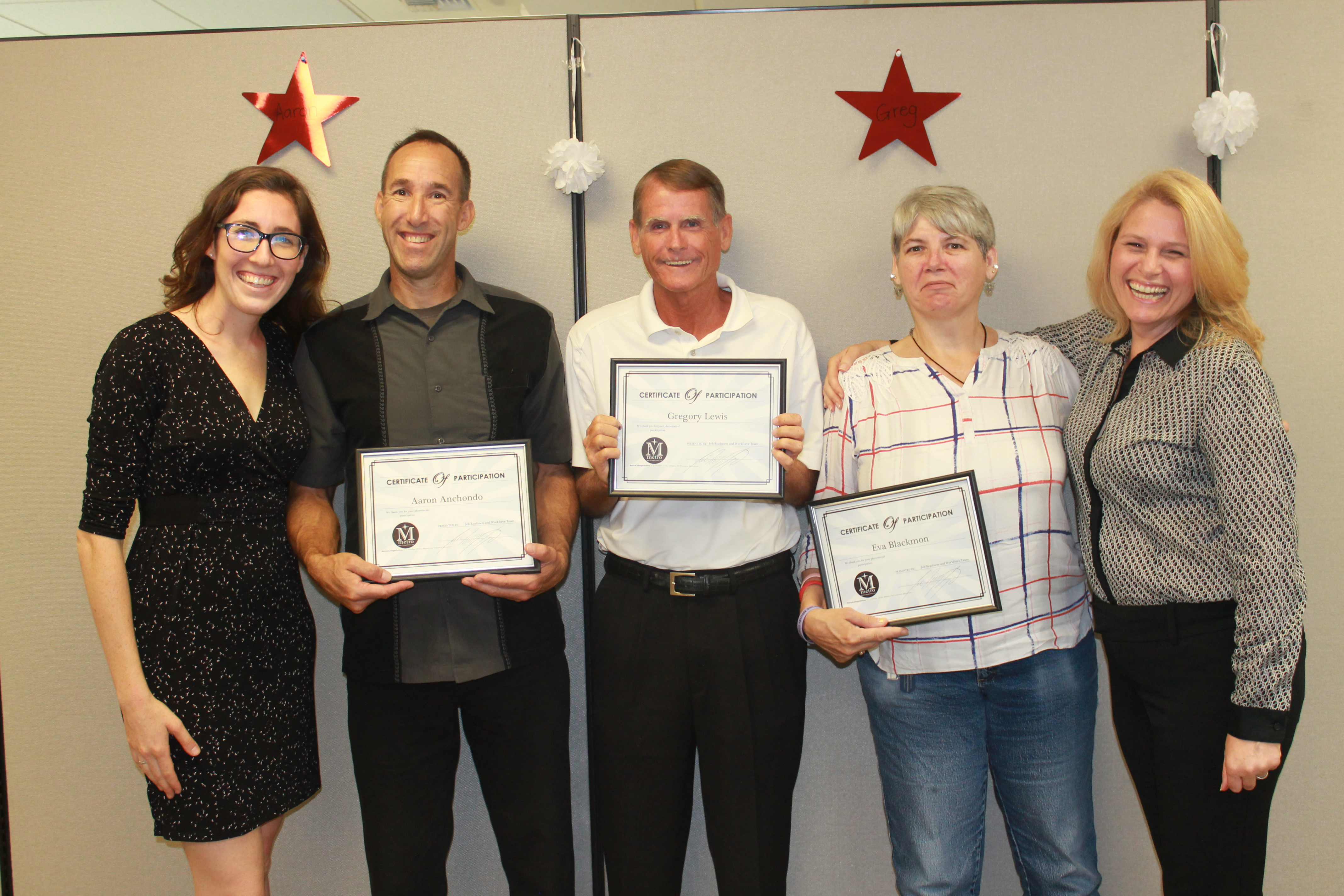 men and women holding certificates at Lawrence welk resort hiring event
