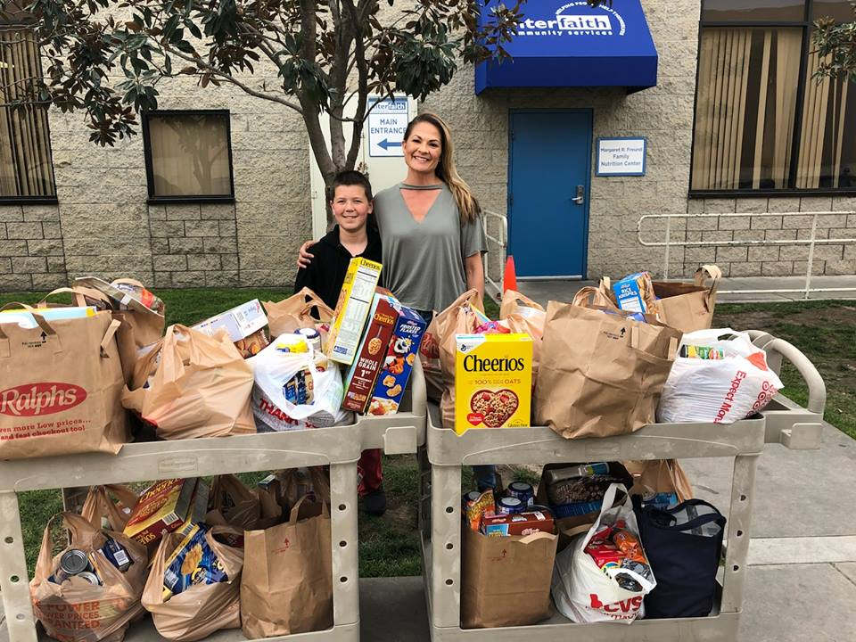 seventh grader and mother donating 700 pounds of food
